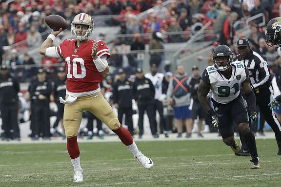 San Francisco 49ers quarterback Jimmy Garoppolo (10) passes against the Jacksonville Jaguars during the first half of an NFL football game in Santa Clara, Calif., Sunday, Dec. 24, 2017. (AP Photo/Marcio Jose Sanchez)