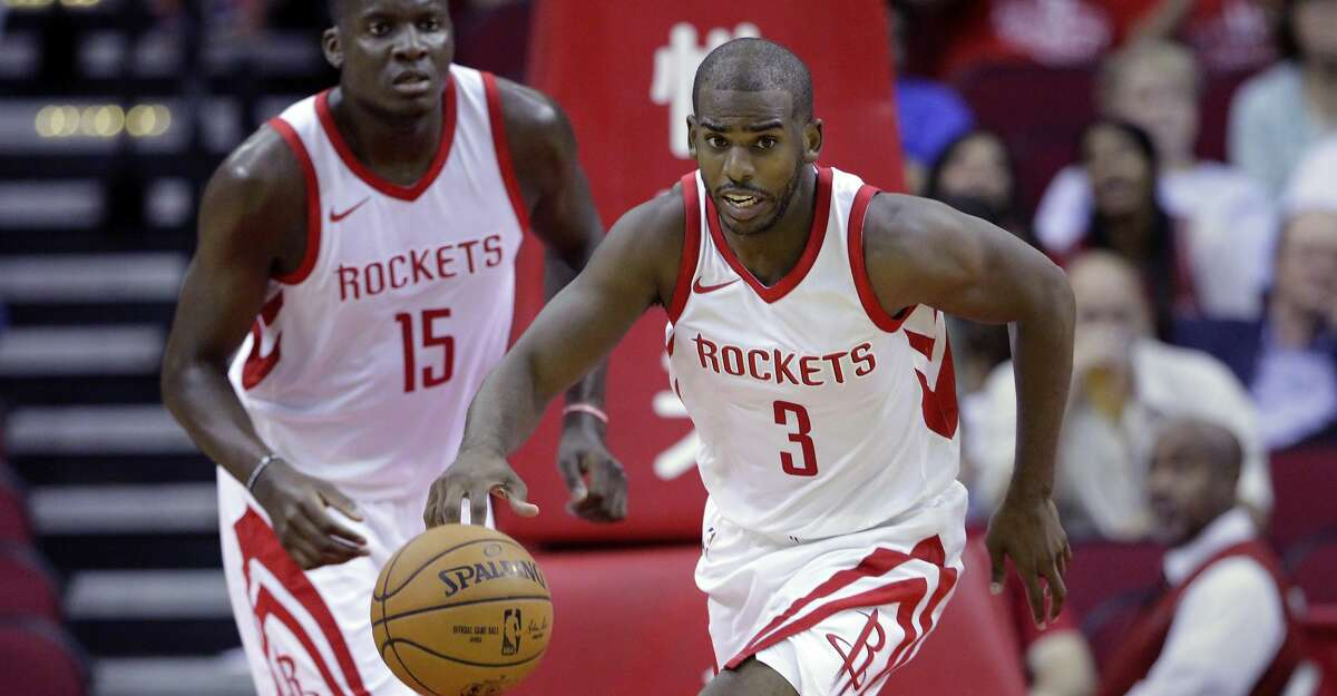 FILE - In this Oct. 5, 2017, file photo, Houston Rockets center Clint Capela (15) follows Chris Paul (3) as he bring the ball down court in the second half of an NBA exhibition basketball game against the Shanghai Sharks, in Houston. The Rockets believe adding Chris Paul to a team led by James Harden helps close the gap between them and Golden State. They'll find out how they stack up against the champions early when they open the season there on Tuesday. (AP Photo/Michael Wyke, File)