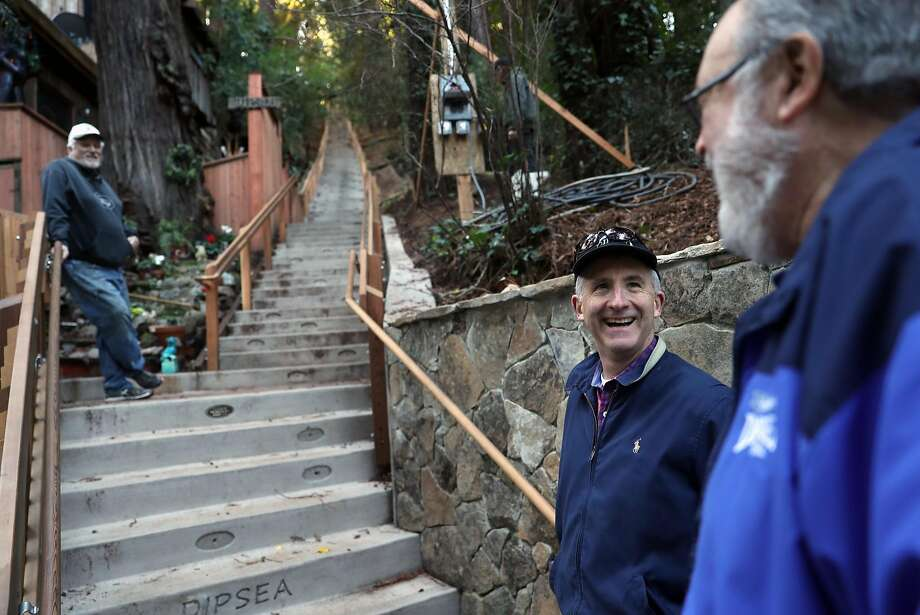 Guy Palmer (top), Eric Ellisen and Merv Regan chat at the recently rebuilt Dipsea steps in Mill Valley. The climb is made of three flights that after renovation number 690 steps, up from 671. Photo: Scott Strazzante, The Chronicle