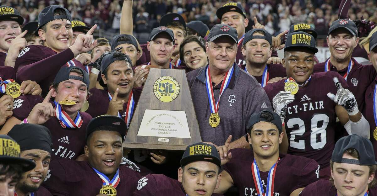 Cy-Fair Head Coach Ed Pustejovsky and his team pose for a photo with the state title plaque after winning the Class 6A Division II State Championship Game at AT&T Stadium on Saturday, Dec. 23, 2017, in Arlington. The Cy-Fair Bobcats defeated the Waco Midway Panthers 51-35 and won the state championship title. ( Yi-Chin Lee / Houston Chronicle )
