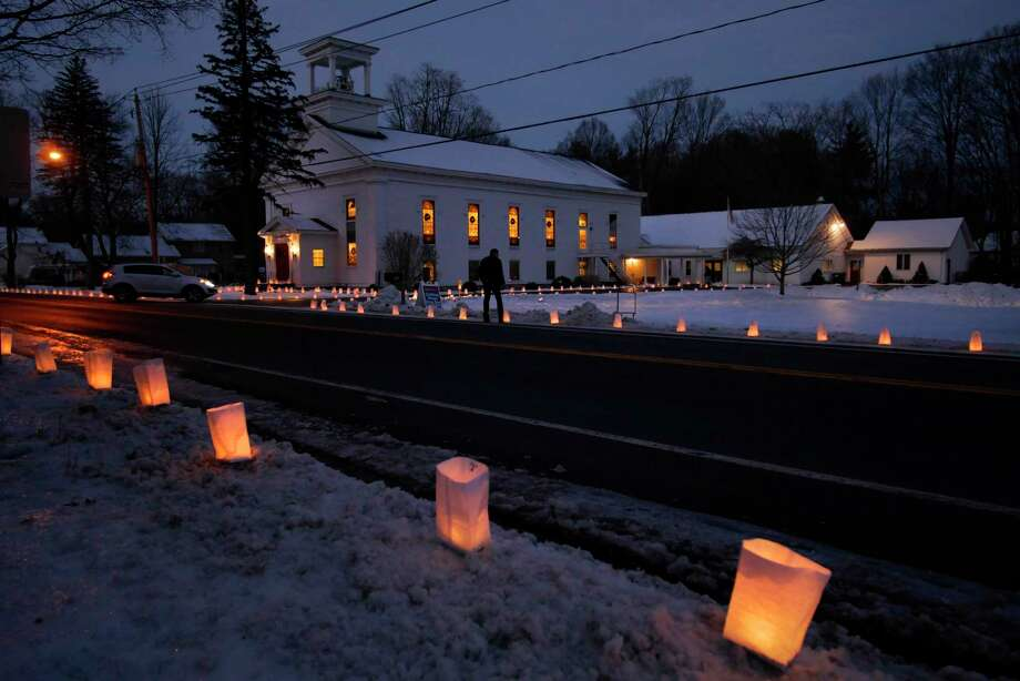 Luminaries are seen outside the Jonesville United Methodist Church on Sunday, Dec. 24, 2017, in Clifton Park, N.Y.  For the past 35 years members of the Methodist Youth Fellowship at the church have been holding the Luminaria Lighting Tradition on Christmas Eve.  The luminaries are placed all around the church and thousands more are bought by community members to line outside their homes too.  The money raised is used to fund youth group activities including a week-long work camp in the summer where the children travel to help a community with fixing up homes.   (Paul Buckowski / Times Union) Photo: PAUL BUCKOWSKI / 20042482A