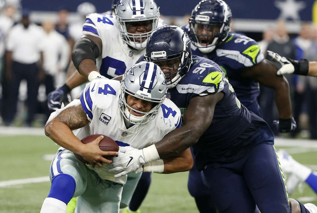 SEAHAWKS' PASS RUSH SHOWED UP FOR FIRST TIME THIS SEASON The Seahawks sacked Cowboys quarterback Dak Prescott five times, which is two more sacks than they had in their first two games combined. Left tackle Jarran Reed led the way with two, while three others had one apiece. Defensive end Frank Clark now has three sacks through three games. Linebacker Barkevious Mingo got the sack party going in an electric way when he took down Prescott at the Dallas 20 for a loss of 10 yards in the second quarter.