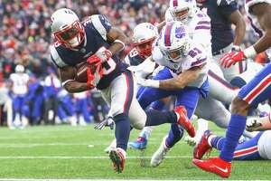 FOXBORO, MA - DECEMBER 24:  Dion Lewis #33 of the New England Patriots scores a touchdown during the fourth quarter of a game against the Buffalo Bills at Gillette Stadium on December 24, 2017 in Foxboro, Massachusetts.  (Photo by Maddie Meyer/Getty Images)