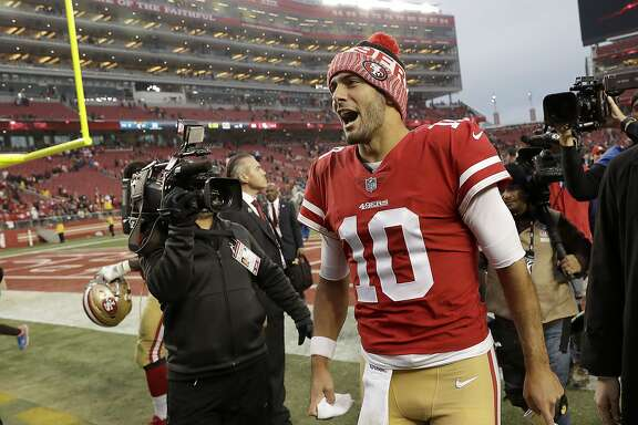 San Francisco 49ers quarterback Jimmy Garoppolo (10) celebrates after the 49ers beat the Jacksonville Jaguars 44-33 in an NFL football game in Santa Clara, Calif., Sunday, Dec. 24, 2017. (AP Photo/Marcio Jose Sanchez)