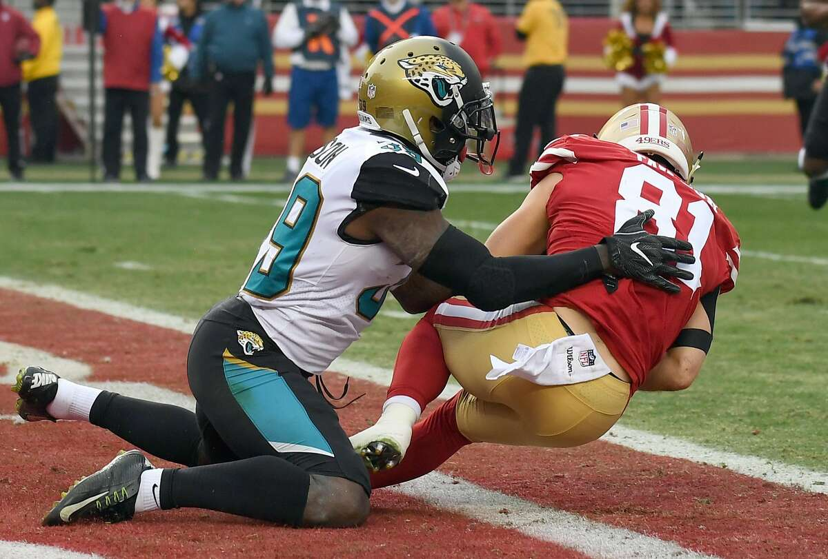 SANTA CLARA, CA - DECEMBER 24: Trent Taylor #81 of the San Francisco 49ers catches a touchdown pass in front of Tashaun Gipson #39 of the Jacksonville Jaguars during their NFL football game at Levi's Stadium on December 24, 2017 in Santa Clara, California. (Photo by Thearon W. Henderson/Getty Images)