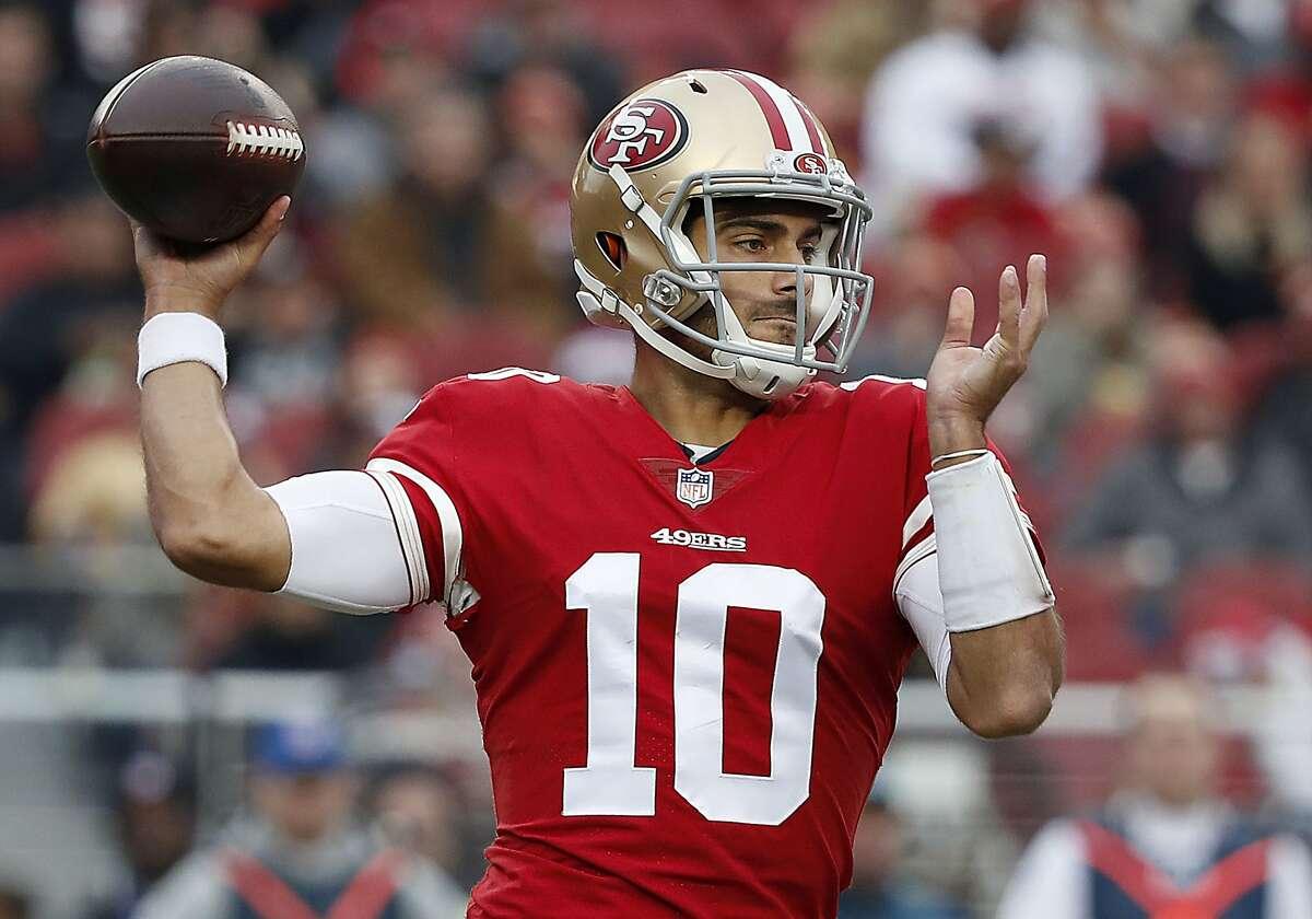 San Francisco 49ers quarterback Jimmy Garoppolo (10) passes against the Jacksonville Jaguars during the first half of an NFL football game in Santa Clara, Calif., Sunday, Dec. 24, 2017. (AP Photo/Tony Avelar)