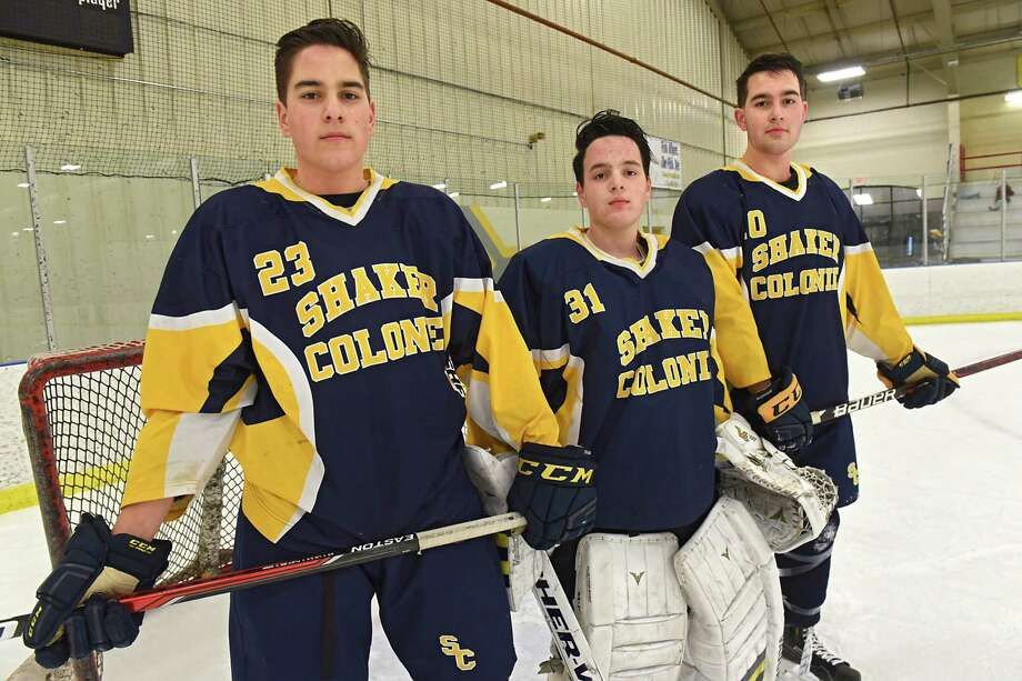 Shaker/Colonie senior hockey triplets, from left, Mike, Dan and Joe Molloy stand in front of the net at the Albany County Hockey Rink on Thursday, Dec. 21, 2017 in Albany N.Y. (Lori Van Buren / Times Union) Photo: Lori Van Buren / 20042471A