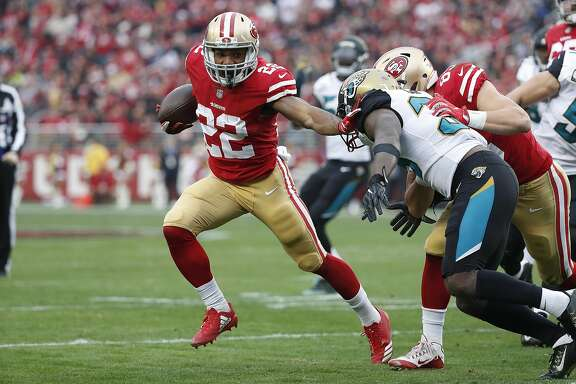 San Francisco 49ers running back Matt Breida (22) runs against the Jacksonville Jaguars during the first half of an NFL football game in Santa Clara, Calif., Sunday, Dec. 24, 2017. (AP Photo/Tony Avelar)