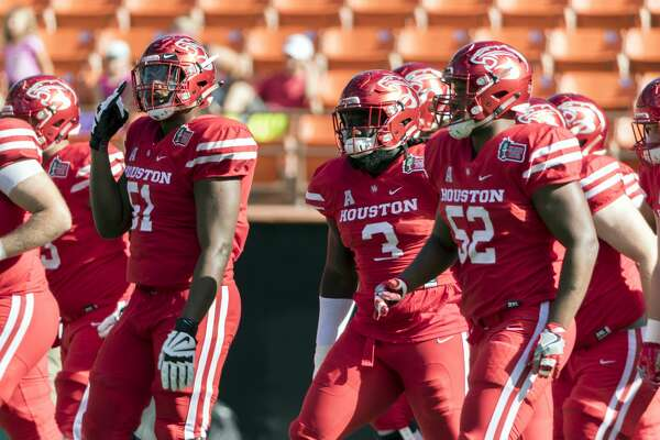 Houston players participate in warmups before the Hawaii Bowl NCAA college football game against Fresno State, Sunday, Dec. 24, 2017, in Honolulu. (AP Photo/Eugene Tanner)