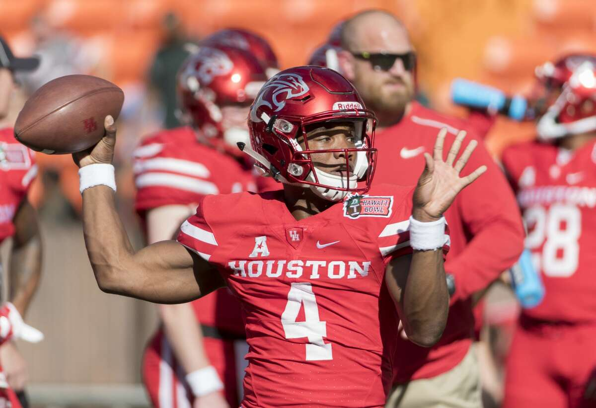 Houston quarterback D'Eriq King (4) throws a pass before the Hawaii Bowl NCAA college football game against Fresno State, Sunday, Dec. 24, 2017, in Honolulu. (AP Photo/Eugene Tanner)