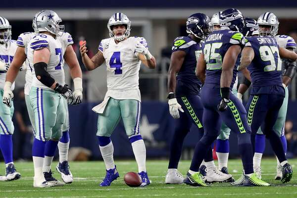 ARLINGTON, TX - DECEMBER 24:  Dak Prescott #4 of the Dallas Cowboys reacts after being sacked by the Seattle Seahawks in the fourth quarter at AT&T Stadium on December 24, 2017 in Arlington, Texas.  (Photo by Tom Pennington/Getty Images)