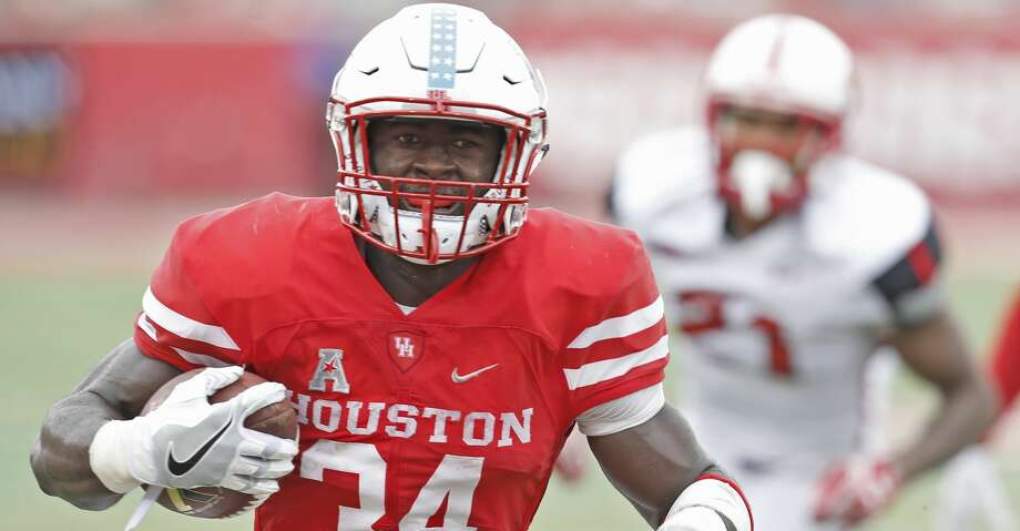 HOUSTON, TX - SEPTEMBER 10: Running back Mulbah Car #34 of the Houston Cougars rushes against the Lamar Cardinals in the second half at TDECU Stadium on September 10, 2016 in Houston, Texas. Houston won 42 to 0.  (Photo by Thomas B. Shea/Getty Images) Photo: Thomas B. Shea/Getty Images