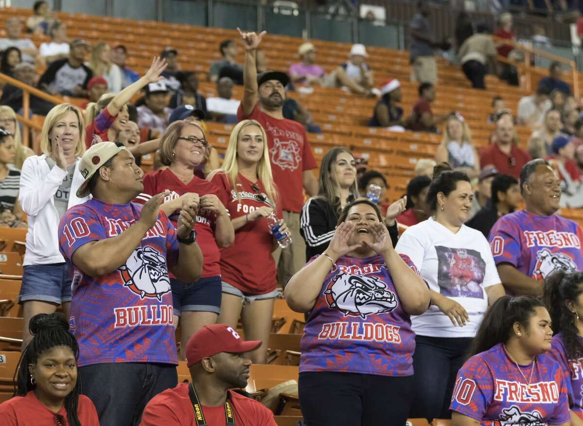 Fresno State fans cheer on their team at the Hawaii Bowl NCAA college football game against Houston, Sunday, Dec. 24, 2017, in Honolulu. Fresno State won, 33-27. (AP Photo/Eugene Tanner)