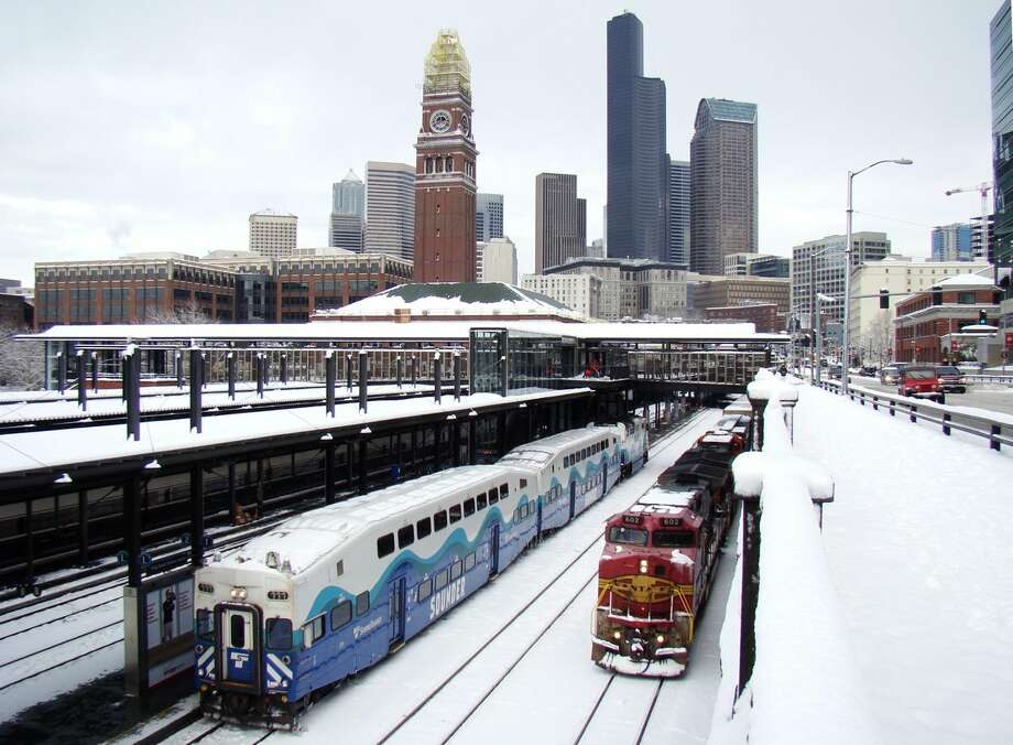 A Christmas Eve snow storm delivered Seattle's seventh White Christmas. Above, trains on snowy rails pass south of Seattle's downtown. Click through for a look at some of SeattlePI's best snow photos. Photo: Seattle Department Of Transportation