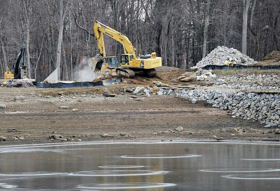 Construction work at the Rockwood Reservoir off North Street in Greenwich, Conn., Wednesday, Dec. 20, 2017. Photo: Bob Luckey Jr. / Hearst Connecticut Media / Greenwich Time