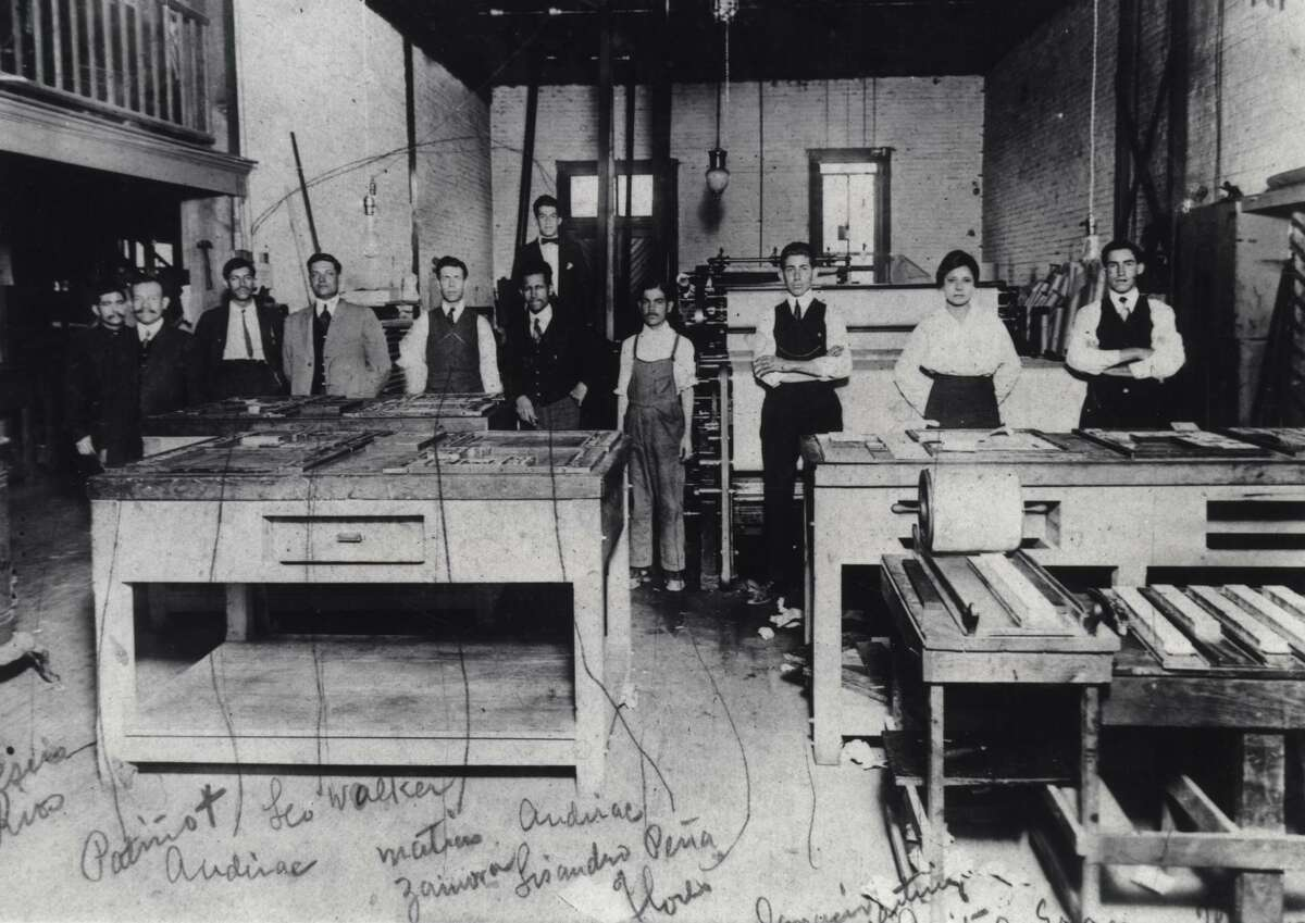 Jovita Idar (second from right) stands in the print shop of El Progreso, a newspaper she worked for in Laredo in the early 1900s. She was a rarity in what was then a male-dominated industry. The other newspaper employees are identified in handwriting on the photo, dated 1914. That year, she held off Texas Rangers who were trying to shut down the paper after it published an editorial critical of the U.S. invasion of Veracruz.