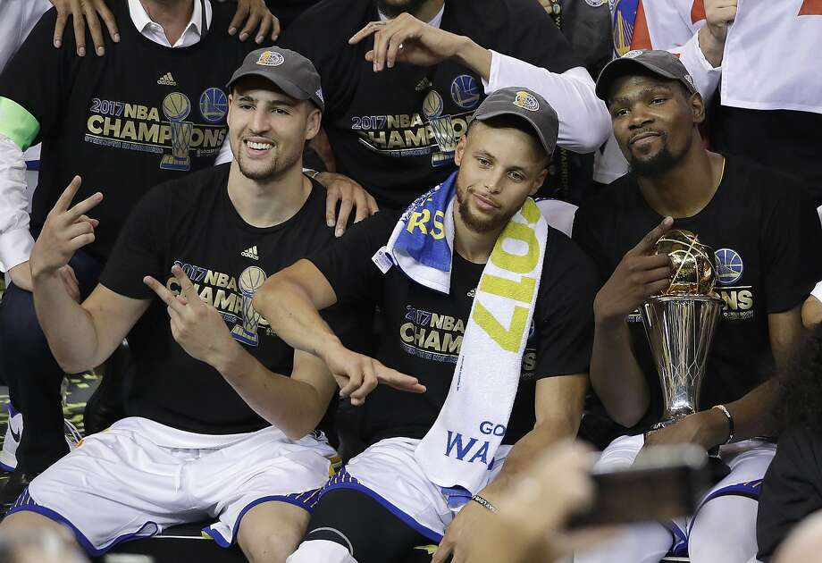 FILE - In this June 12, 2017, file photo, Golden State Warriors guard Klay Thompson, from left, guard Stephen Curry and forward Kevin Durant celebrate after Game 5 of basketball's NBA Finals against the Cleveland Cavaliers in Oakland, Calif. Durant leading the Golden State Warriors to the NBA championship over the defending champion Cleveland Cavaliers was one of the biggest sports stories in 2017. (AP Photo/Marcio Jose Sanchez, File) Photo: Marcio Jose Sanchez, Associated Press
