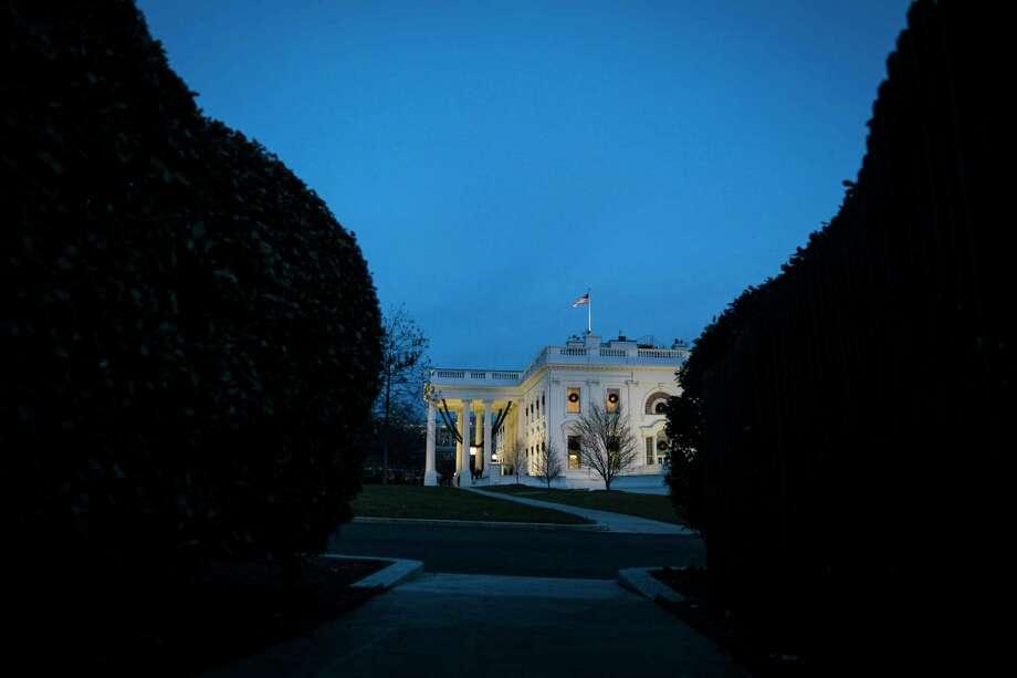 The sun sets at the White House on Dec. 19. Photo: Washington Post Photo By Jabin Botsford / The Washington Post