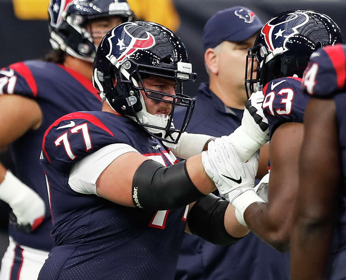 Houston Texans offensive guard David Quessenberry (77) warsm up before an NFL football game against the Pittsburgh Steelers at NRG Stadium on Monday, Dec. 25, 2017, in Houston. It is the first time Quessenberry has been on the Texans active roster since his cancer diagnosis.