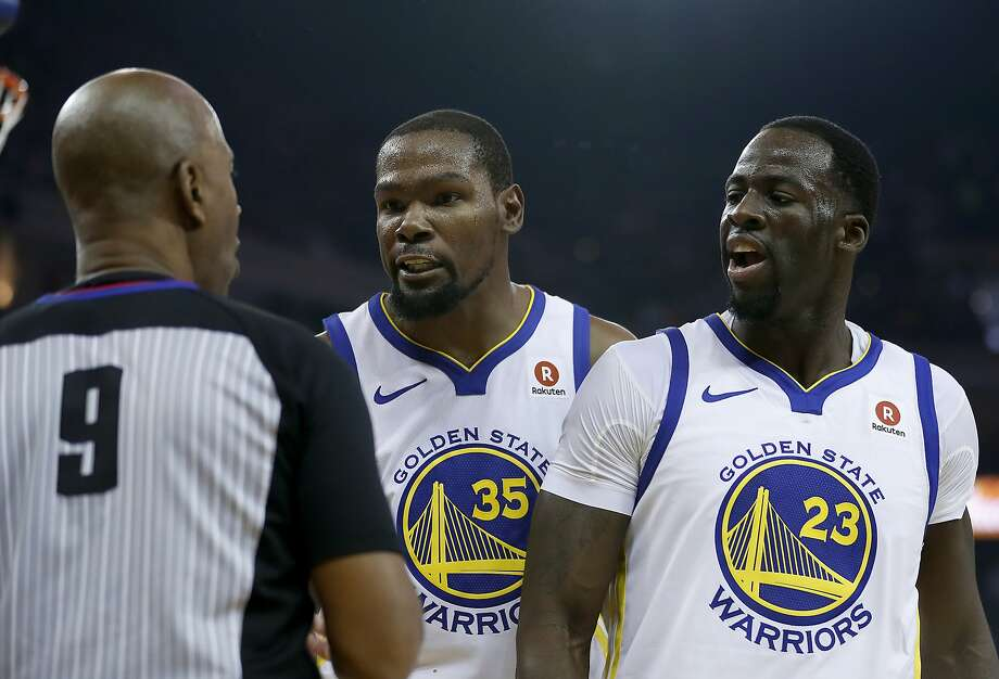 Golden State Warriors forward Kevin Durant (35) and forward Draymond Green (23) argue a call with referee Derrick Stafford (9) during the first half against the Cleveland Cavaliers of an NBA basketball game in Oakland, Calif., Monday, Dec. 25, 2017. (AP Photo/Tony Avelar) Photo: Tony Avelar, Associated Press