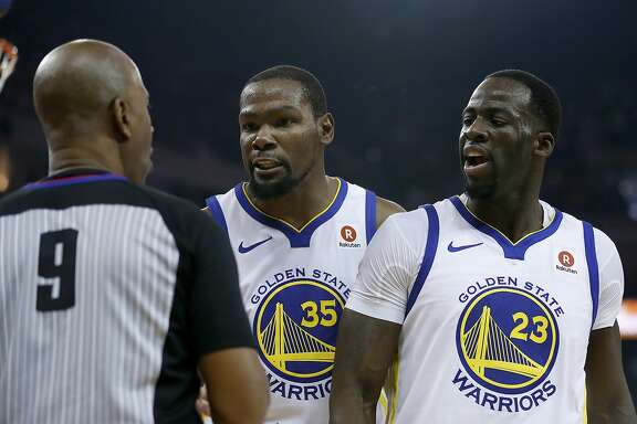 Golden State Warriors forward Kevin Durant (35) and forward Draymond Green (23) argue a call with referee Derrick Stafford (9) during the first half against the Cleveland Cavaliers of an NBA basketball game in Oakland, Calif., Monday, Dec. 25, 2017. (AP Photo/Tony Avelar)
