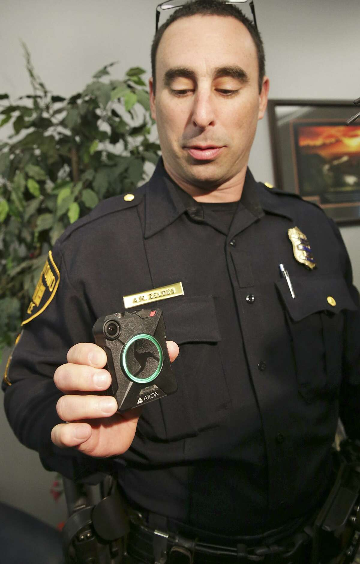 Sgt. Adam Zeldes displays his body-worn camera during a demonstration of the new equipment on Feb. 17, 2016 . A recent report by The Leadership Conference and Upturn found that four of the San Antonio Police Department's policies regulating body-worn cameras fail to meet civil-rights safeguards.