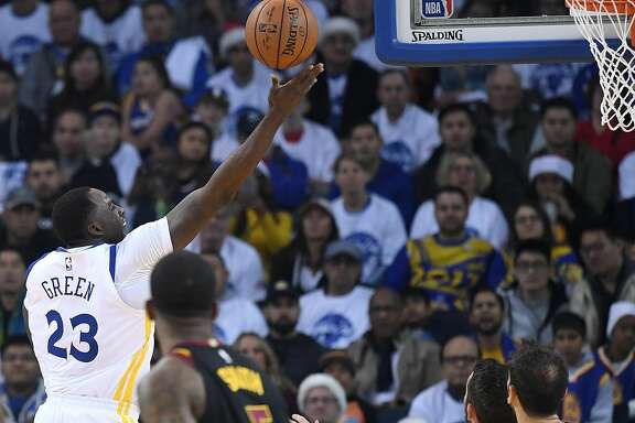 OAKLAND, CA - DECEMBER 25:  Draymond Green #23 of the Golden State Warriors goes up for a layup against the Cleveland Cavaliers during an NBA basketball game at ORACLE Arena on December 25, 2017 in Oakland, California. NOTE TO USER: User expressly acknowledges and agrees that, by downloading and or using this photograph, User is consenting to the terms and conditions of the Getty Images License Agreement.  (Photo by Thearon W. Henderson/Getty Images)