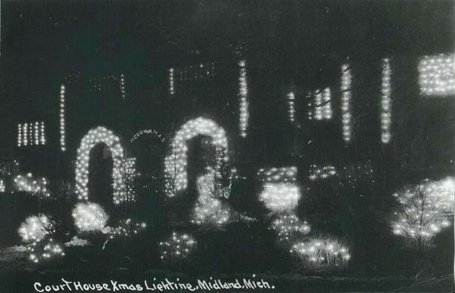 Elzie Cote was the man behind the courthouse Christmas decorations. Huckleberry bushes were dug up and transplanted temporarily on the courthouse lawn and then decorated with strings of colored electric lights. People drove from miles around to see the lights there. Grace Ball Dow paid for the decorations.