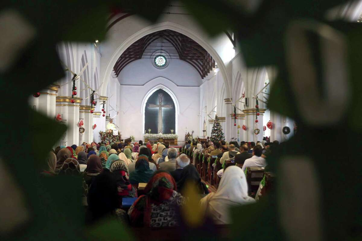 Pakistani Christians attend Christmas mass at St. John Cathedral in Peshawar, Pakistan, Monday, Dec. 25, 2017. (AP Photo/Mohammad Sajjad)