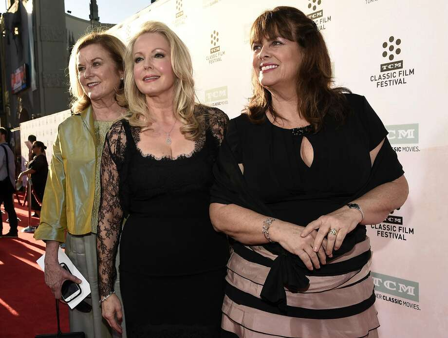 "Heather Menzies-Urich (left) attends a 50th anniversary screening of ""The Sound of Music"" with fellow cast members Kym Karath and Debbie Turner. Photo: Chris Pizzello, Associated Press"
