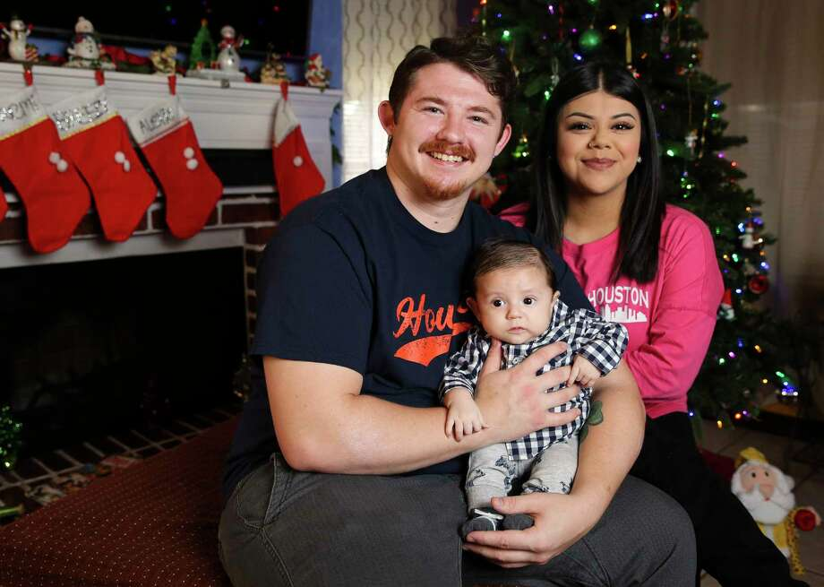 Michael Cassidy, 26, and his fiance, Alexis Garcia, 22, holding their two-month-old son, Azrael Cassidy, for a portrait on Sunday, Dec. 10, 2017, in Houston. A special medical tourniquet device saved Cassidy when he was involved in a bad motorcycle accident back in March, and now he would be celebrating Christmas with his new family. Photo: Yi-Chin Lee, Houston Chronicle / © 2017  Houston Chronicle