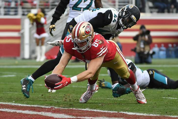 SANTA CLARA, CA - DECEMBER 24:  George Kittle #85 of the San Francisco 49ers dives into the end zone for a touchdown against the Jacksonville Jaguars during their NFL game at Levi's Stadium on December 24, 2017 in Santa Clara, California.  (Photo by Robert Reiners/Getty Images) ***BESTPIX***