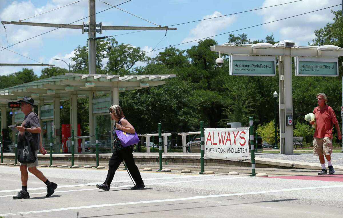 Metropolitan Transit Authority, Rice University and the City of Houston collaborated to make the crosswalk at the Hermann Park / Rice train stop safer, adding signs and painting the train tracks sections red, as seen on July 26.