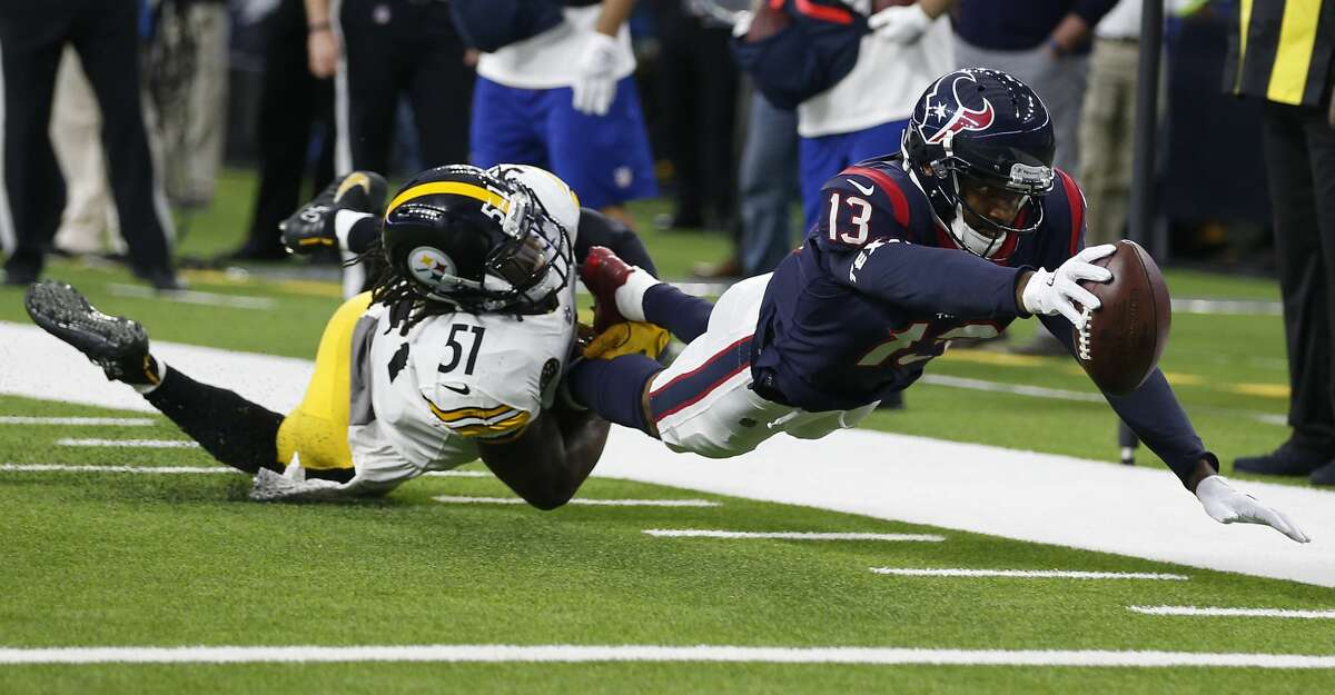 Houston Texans wide receiver Braxton Miller (13) stretches the football toward the goal line as he is tackled short of the goal line by Pittsburgh Steelers linebacker Sean Spence (51) during the second quarter of an NFL football game at NRG Stadium on Monday, Dec. 25, 2017, in Houston. ( Brett Coomer / Houston Chronicle )