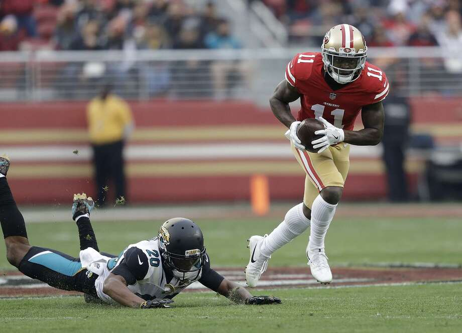49ers wide receiver Marquise Goodwin runs past Jaguars cornerback Jalen Ramsey. The 49ers put up 44 points on a team that had been allowing fewer than 15 points per game. Photo: Marcio Jose Sanchez / Associated Press / Copyright 2017 The Associated Press. All rights reserved.