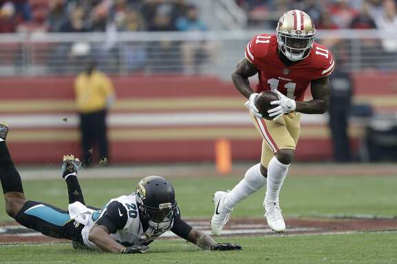 49ers wide receiver Marquise Goodwin runs past Jaguars cornerback Jalen Ramsey. The 49ers put up 44 points on a team that had been allowing fewer than 15 points per game.