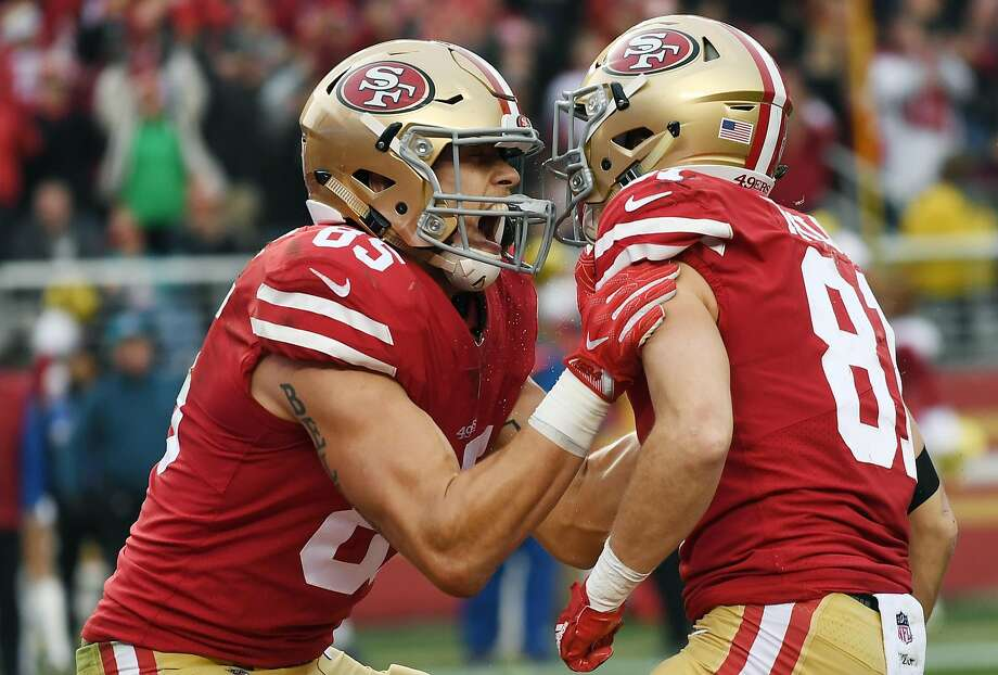 Two 49ers' rookies — wide receiver Trent Taylor (81) and George Kittle (85) — cele brate after Taylor caught a touchdown pass against the Jaguars. Kittle grab bed the 49ers' other touchdown in the 44-33 win at home. Photo: Thearon W. Henderson, Getty Images