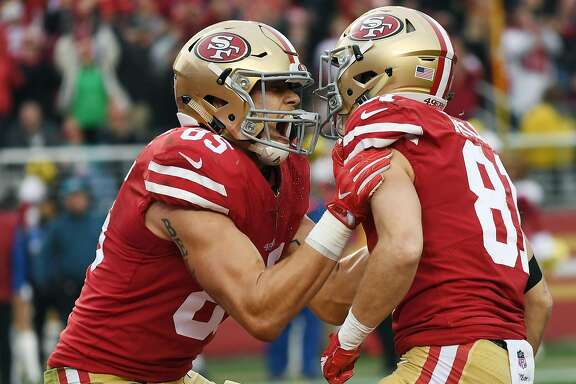 SANTA CLARA, CA - DECEMBER 24:  Trent Taylor #81 and George Kittle #85 of the San Francisco 49ers celebrates after Taylor caught a touchdown pass against the Jacksonville Jaguars during their NFL football game at Levi's Stadium on December 24, 2017 in Santa Clara, California.  (Photo by Thearon W. Henderson/Getty Images)