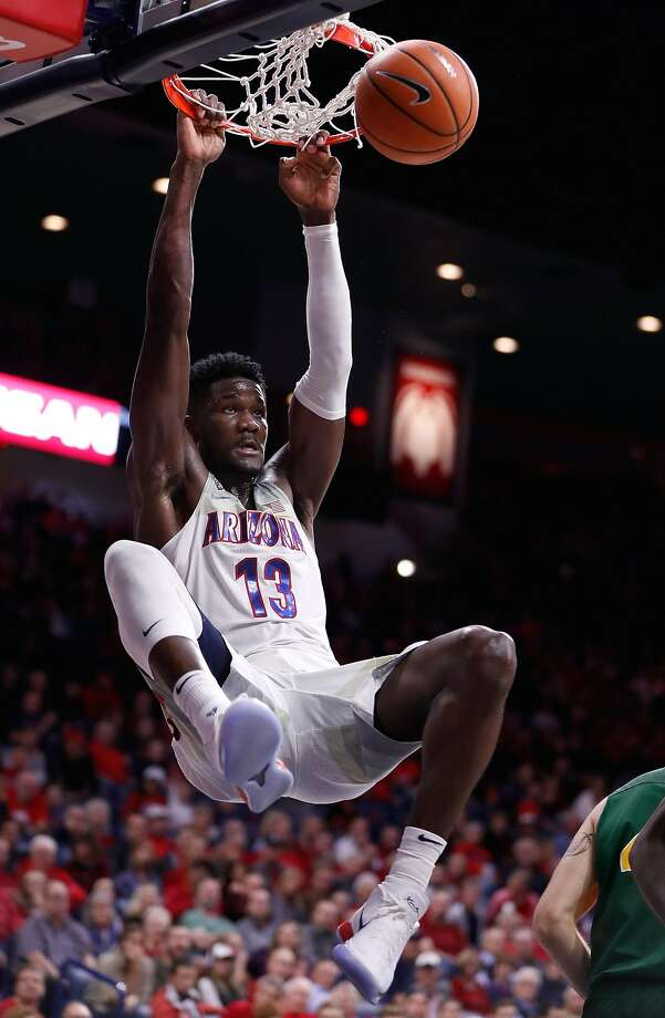 TUCSON, AZ - DECEMBER 18: Deandre Ayton #13 of the Arizona Wildcats dunks during the second half of the college basketball game against the North Dakota State Bison at McKale Center on December 18, 2017 in Tucson, Arizona. (Photo by Chris Coduto/Getty Images) Photo: Chris Coduto, Getty Images