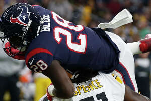 Houston Texans running back Alfred Blue (28) is stopped short of the goal line by Pittsburgh Steelers linebacker Sean Spence (51) during the second quarter of an NFL football game at NRG Stadium on Monday, Dec. 25, 2017, in Houston. ( Brett Coomer / Houston Chronicle )