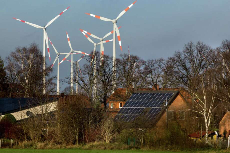 "Germany's investment in promoting cleaner sources of electricity - such as this solar and wind power plant in Brandenburg - has led sometimes to ""negative prices,"" when consumers are actually paid to use power, as was the case over the weekend. Photo: GORDON WELTERS, STR / NYTNS"