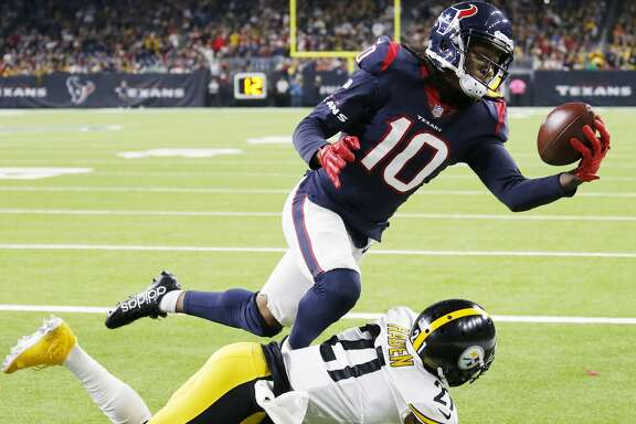 Houston Texans wide receiver DeAndre Hopkins makes a one-handed touchdown catch over Pittsburgh Steelers cornerback Joe Haden during the fourth quarter of an NFL football game, Monday, Dec. 25, 2017 in Houston. The Steelers defeated the Texans 34-6. (Kevin M. Cox/The Galveston County Daily News via AP)