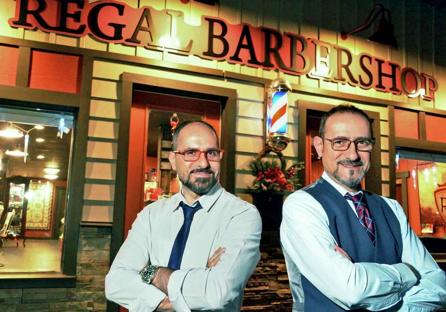 Barbers and brothers Sam, left, and George Jacob in front of their Regal Barbershop Friday Dec. 15, 2017 in Saratoga Springs, NY.  (John Carl D'Annibale / Times Union) Photo: John Carl D'Annibale / 20042377A