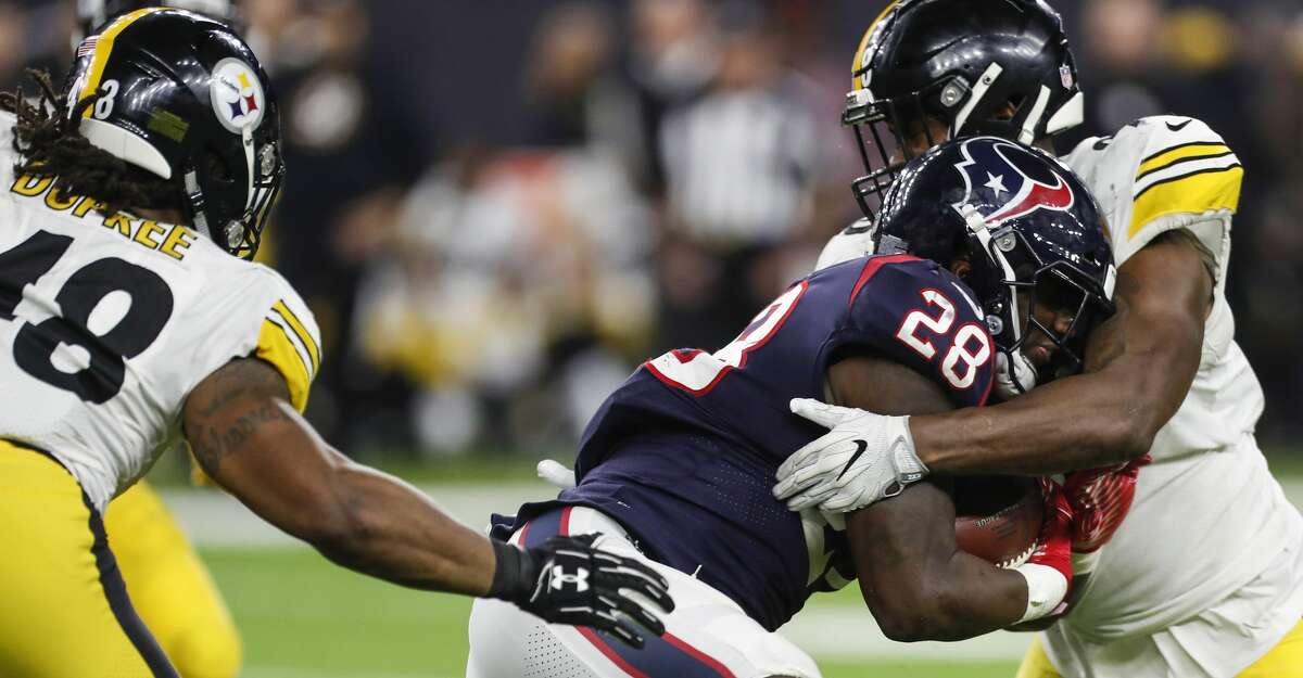 Houston Texans running back Alfred Blue (28) fights for extra yardage on a run against the Pittsburgh Steelers defense during the fourth quarter of an NFL football game at NRG Stadium on Monday, Dec. 25, 2017, in Houston. ( Brett Coomer / Houston Chronicle )