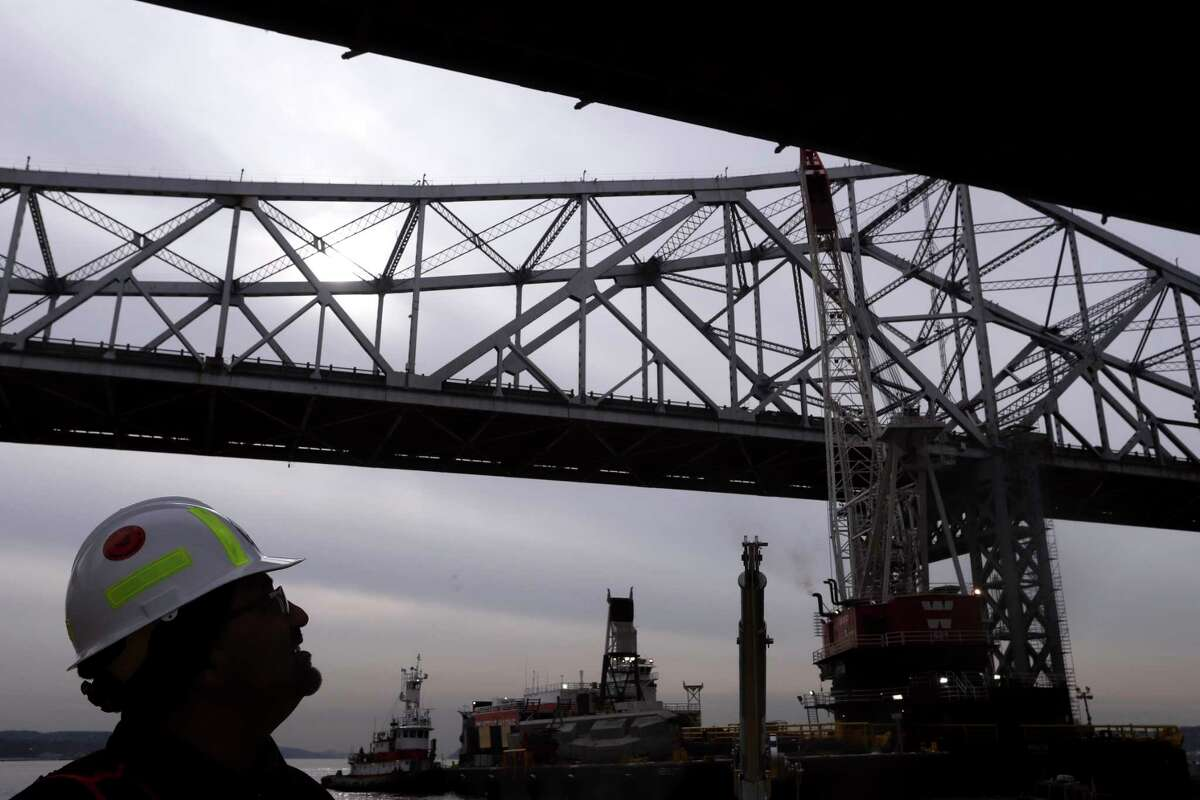 The Tappan Zee Bridge, which crosses the Hudson River north of New York City, in Tarrytown, N.Y., Dec. 15, 2017. The bridge, replaced by the nearby Gov. Mario M. Cuomo Bridge, is being dismantled piece by piece because environmental regulations meant to protect the Hudson prevent demolition. (Rick Loomis/The New York Times)