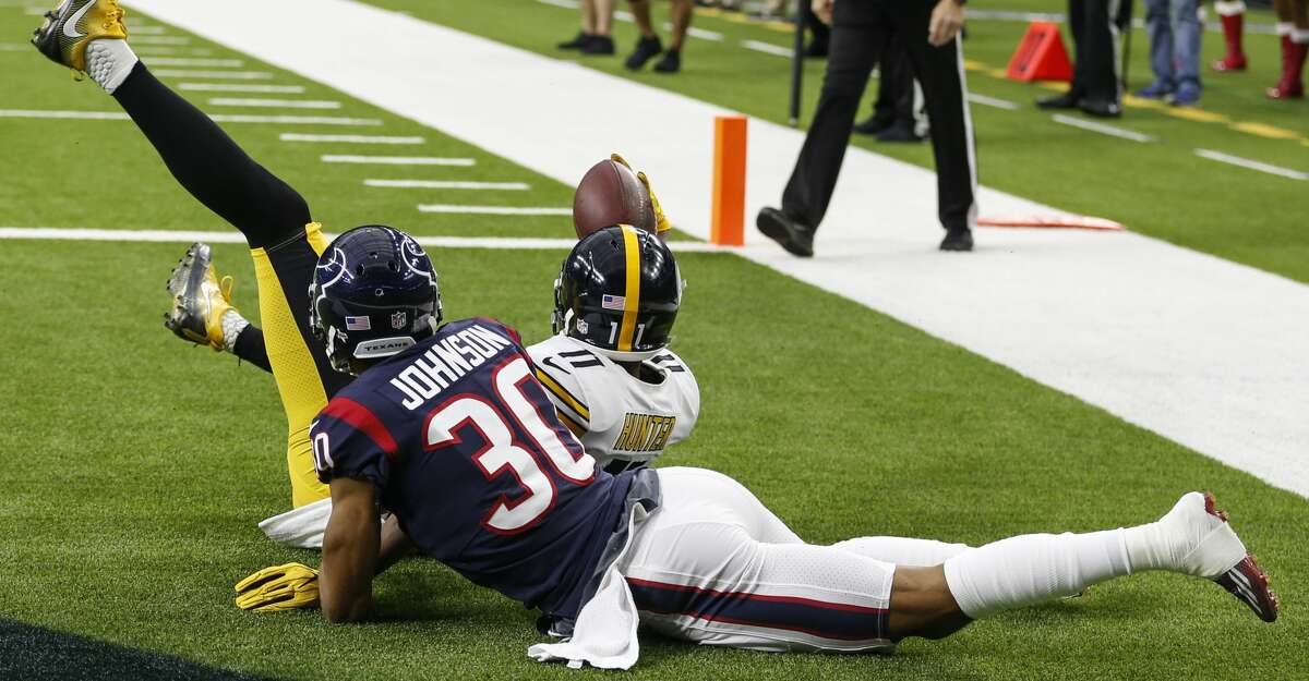 Pittsburgh Steelers wide receiver Justin Hunter (11) makes a 5-yard touchdown reception against Houston Texans cornerback Kevin Johnson (30) during the first quarter of an NFL football game at NRG Stadium on Monday, Dec. 25, 2017, in Houston. ( Brett Coomer / Houston Chronicle )