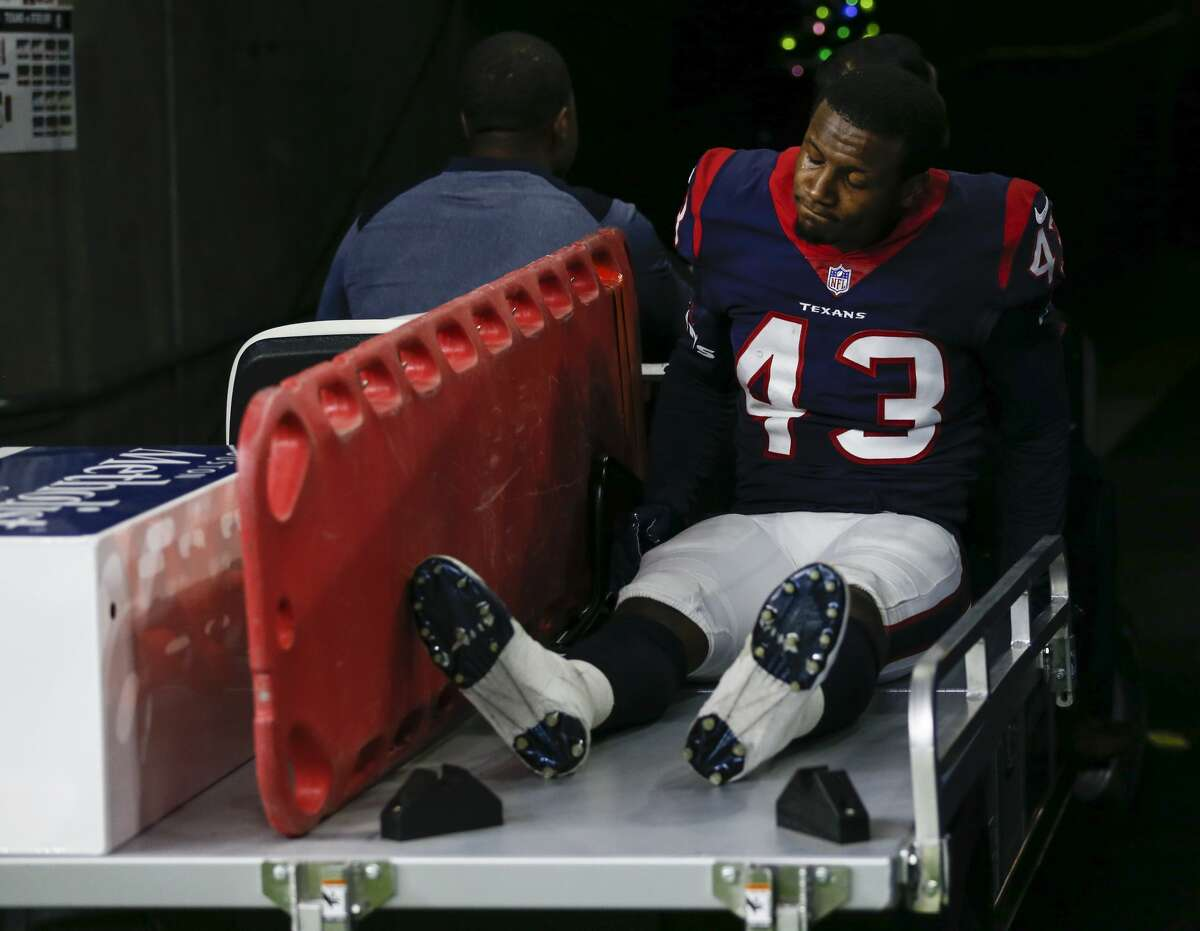 Houston Texans strong safety Corey Moore (43) is carted off the field during the fourth quarter of an NFL football game at NRG Stadium on Monday, Dec. 25, 2017, in Houston. ( Brett Coomer / Houston Chronicle )