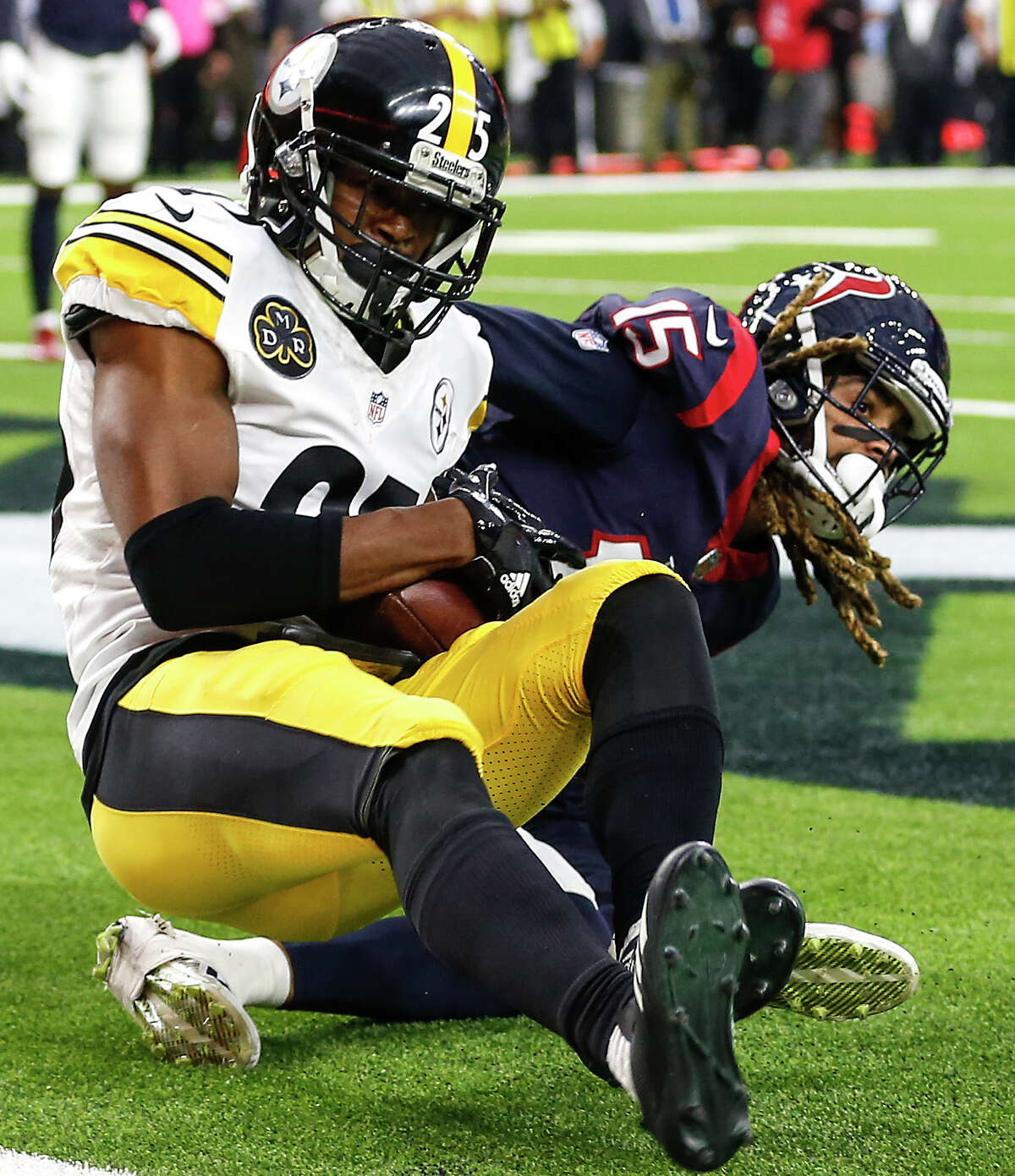 Pittsburgh Steelers cornerback Artie Burns (25) intercepts a pass intended for Houston Texans wide receiver Will Fuller (15) in the end zone during the second quarter of an NFL football game at NRG Stadium on Monday, Dec. 25, 2017, in Houston. ( Brett Coomer / Houston Chronicle )