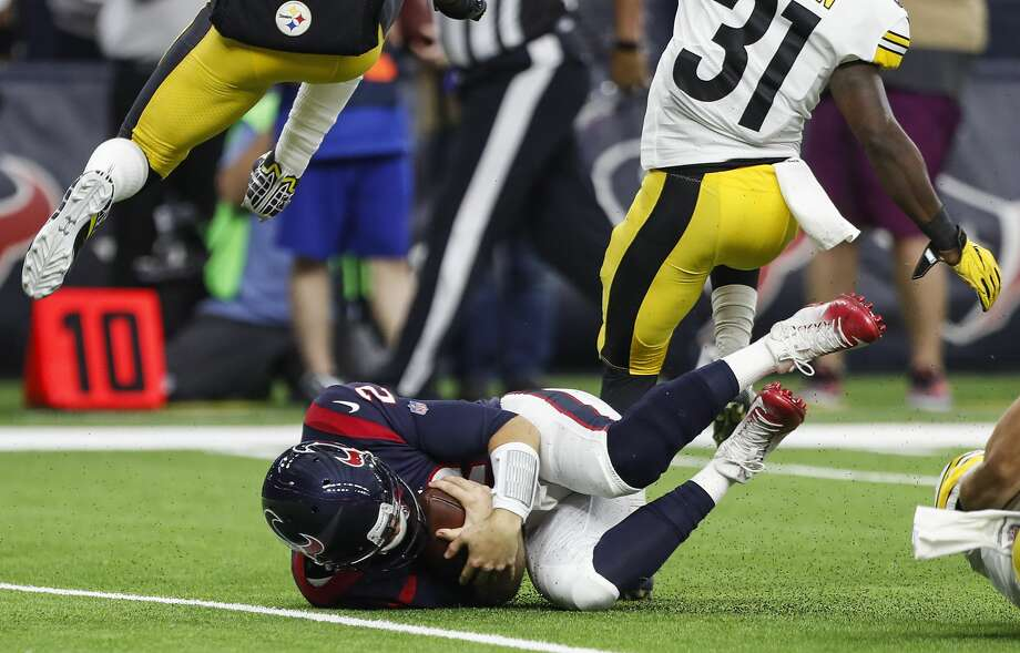 Houston Texans quarterback T.J. Yates (2) falls to the turf after he wass forced out of the pocket by the Pittsburgh Steelers defense during the second quarter of an NFL football game at NRG Stadium on Monday, Dec. 25, 2017, in Houston. ( Brett Coomer / Houston Chronicle )PHOTOS: Scroll through the slideshow to see John McClain's NFL power rankings heading into week 17. Photo: Brett Coomer/Houston Chronicle