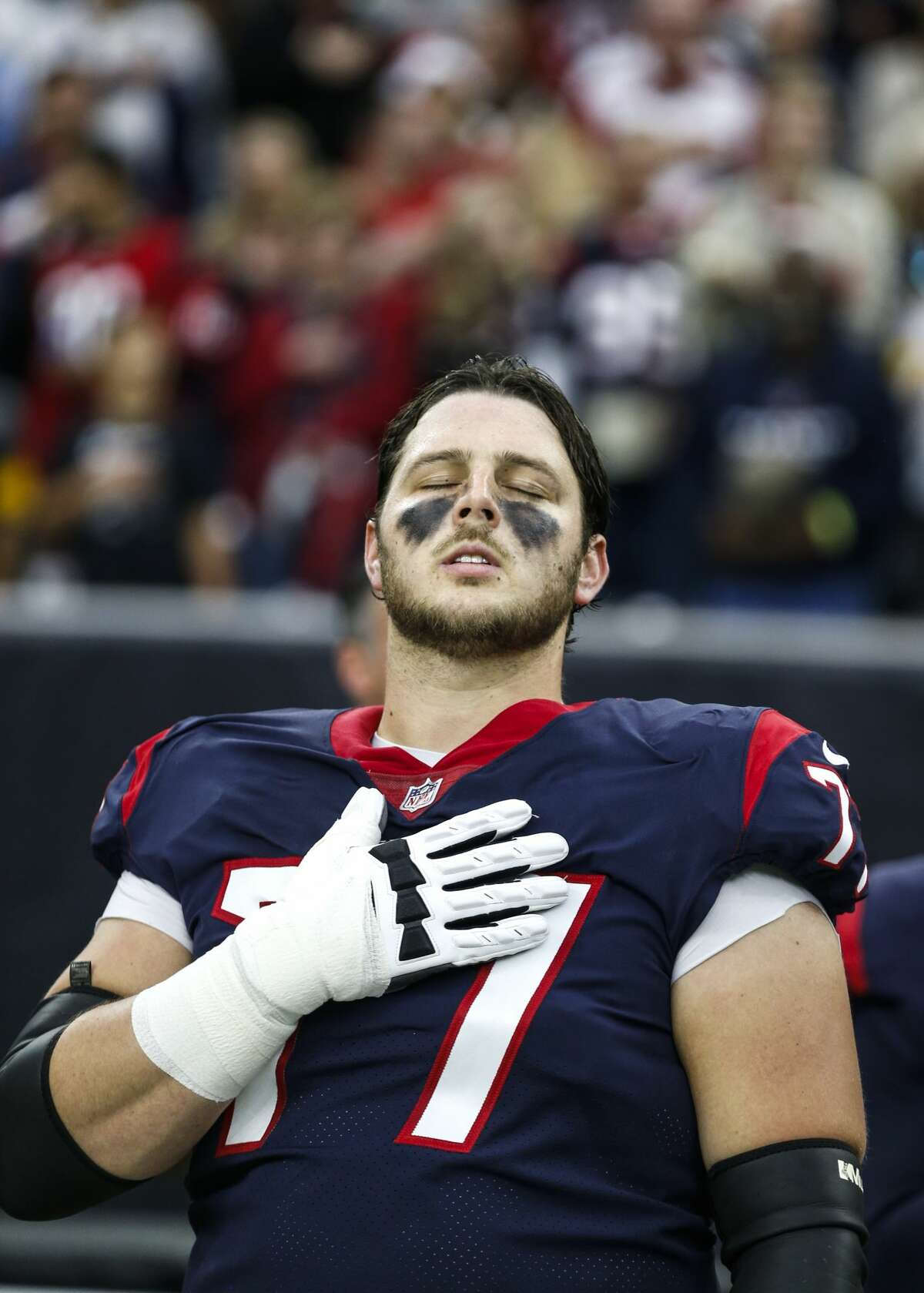Houston Texans offensive guard David Quessenberry (77) closes his eyes as he stands for the national anthem before an NFL football game against the Pittsburgh Steelers at NRG Stadium on Monday, Dec. 25, 2017, in Houston. ( Brett Coomer / Houston Chronicle )